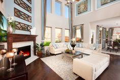 Fabulous family room, with valuted ceilings, picture windows and a gorgeous fireplace!