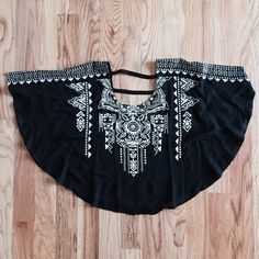 Black Printed Poncho Top NWT. SUPER CUTE. PONCHO STYLE. DETAILED PRINT. PRINT DETAIL ON SLEEVES. CUTOUT BACK. PRICE IS FIRM. Tops Blouses