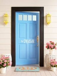 What a colorful entrance! We love this blue door and the crisp white house numbers.