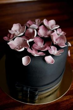Black wedding cake with mauve purple flowers