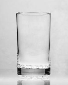 The Smith & Wesson:  1 oz vodka, 1 oz coffee liqueur, 2 oz half and half, club soda to fill