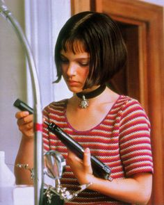 """A very young Natalie Portman as Mathilda in """"Leon The Professional.""""from Luc Besson Natalie Portman Léon, Natalie Portman Mathilda, Leon Matilda, The Professional Movie, Leon The Professional Mathilda, Mathilda Lando, Fancy Dress Wigs, Nathalie Portman, Luc Besson"""