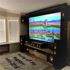 Congrats to today's showcase winner FYI- the entertainment unit is hand crafted from soft barn boards. Home Theater Room Design, Home Cinema Room, Home Theater Decor, At Home Movie Theater, Home Theater Rooms, Home Room Design, Home Theater Sound System, Home Theater Surround Sound, Klipsch Home Theater
