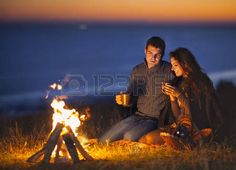 loing couple sitting by fire - Google Search