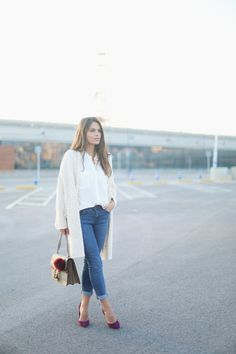 8. jessie chanes - cream oeversized long cardigan blue jeans burgundy heels