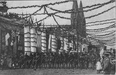 On May 7, 1919, Indianapolis held a grand welcoming parade for soldiers returning from the war in Europe. The parade came through a giant victory arch into Monument Circle and then proceeded north on Meridian Street.