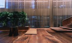 Cascade Coil metal mesh drapery to support a natural and industrial edge design. (Oh, and check out the live edge table! Ceiling Treatments, Window Treatments, Commercial Design, Commercial Interiors, Room Divider Curtain, Curtain Room, Metal Curtain, Hotel Architecture, Interior Windows