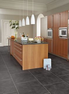 Atlantic Slate Camaro luxury vinyl tile flooring in brickwork layout, featured in kitchen