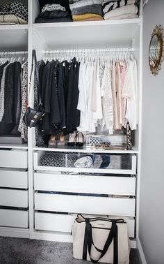 Fantastic walk in closet features an Ikea Pax Closet System boasting clothes rails over pull out drawers including see through drawers. #closetsystem