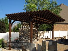 Free standing pergola with Rich Cordoba stain and Roosevelt profile. Upgraded extended rafters.