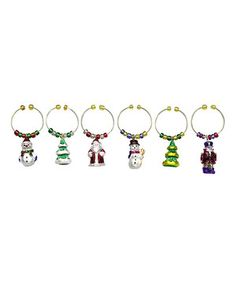 'Tis the season to enjoy delicious drinks and cheerful cocktails. Guests at parties and cozy gatherings can personalize drinks with festive flair by using this sweet set of wine charms.