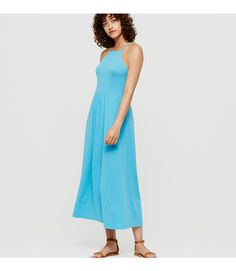 "In soft jersey, angled armholes and a strappy criss-cross back edge out this pretty midi. Square neck. Spaghetti straps go into criss-cross back. 34"" from natural waist."
