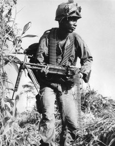 """GI is armed with the M-60 Machine gun IN 7.62 X 51mm with extra ammo each man in the squad or platoon carried extra ammo for the M-60 better known as """"THE PIG"""" to GIs"""