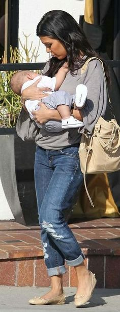 Who made Kourtney Kardashian's jeans, nude ballet flat shoes and nude purse on May 19, 2010? Purse and shoes – Balenciaga  Jeans – Citizens of Humanity