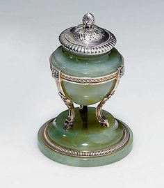 A silver-mounted bowenite inkwell