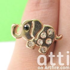 A small elephant animal ring in light bronze   It is a PINKY ring, it is adjustable but will fit a size 5 pinky at the largest.    ---    Handling time:  - Please allow two to three business days for us to process your order  - We will email you when we've sent it out with more information, if yo...