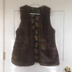 Sanctuary vegan brown furry vest Super cute brown fur vest from Sanctuary. Size small. Worn a handful of times. EUC. No trades, etc. Consider bundling for a discount  Sanctuary Jackets & Coats Vests