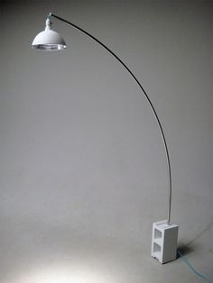 DIY arc lamp - cinder block, work lamp, conduit and paint. (I have a piece of marble that would make a better base, and I'd want a bigger shade, but it's a cool idea for sure. Decor, Floor Standing Lamps, Light Decorations, Diy Lamp, Lamp, Arc Floor Lamps, Diy Floor Lamp, Work Lamp, Concrete Lamp