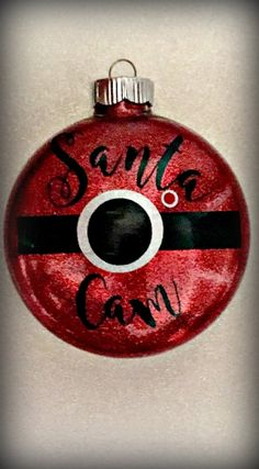 He sees you when your sleeping, he knows when your awake.... Start a holiday tradition with this Santa Cam hanging on your tree!