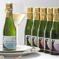 Create lasting Wedding memories with the Silhouette Personalized Sparkling Wine Bottle Favors. Find the best personalized wedding gifts at PersonalizationMall.com