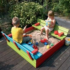 Lots of outdoor play ideas for kids.  I love the idea of the benches with the sandbox :)