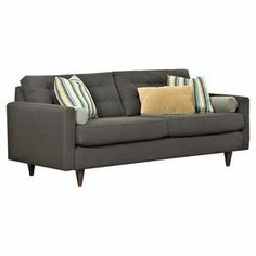 "Showcasing a button-tufted back, track arms, and tapered legs, this contemporary sofa adds a sleek touch to your living room or home library. Made in the USA.   Product: SofaConstruction Material: Kiln-dried hardwood, steel, high-density foam, cotton and polyesterColor: GreyFeatures:  Button-tuftedTrack armsTapered legs Made in the USA Accent pillows included  Dimensions: 32"" H x 86"" W x 37"" D"