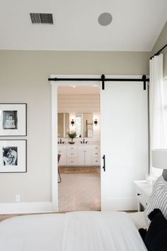 A Sustainable Green Home. Nice idea for the en-suite bathroom off of the bedroom a sliding barn door instead of a regular one. A Sustainable Green Home. Nice idea for the en-suite bathroom off of the bedroom a sliding barn door instead of a regular one. Bathroom Lighting Design, Bathroom Light Fixtures, Up House, House Goals, Home Improvement Projects, Home Builders, Building A House, Green Building, Building Plans