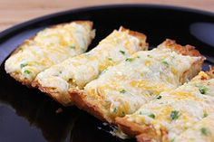 Cheesy Garlic Bread (Guilty Pleasure) -- Ingredients:  Cheddar, Monterey Jack, Parmesan, Mayo, Scallions, Baguette.