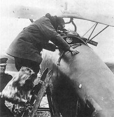 Manfred von Richthofen boards his red Albatros D.III Scout in 1917.
