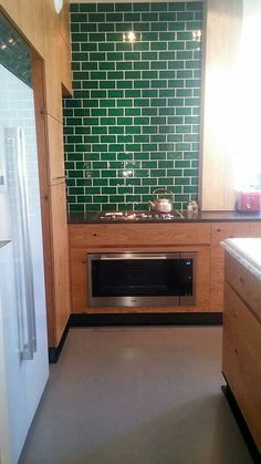 Perfect kitchen and perfect colors. Amazing dark green metro tiles for the backsplash.