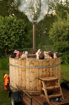 Wine Barrel Hot Tub.  This is too perfect for me :)