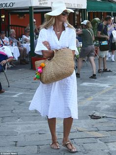 The perfect summer look: Riviera style: Elle Macpherson was stylish in a white sundress and hat on Friday as she arrived in Portofino Elle Macpherson, It Bag, White Outfits, Summer Outfits, White Sundress, Beach Wear, Beachwear For Women, Madame, Holiday Fashion