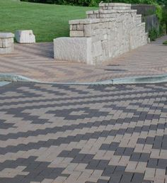 Nifty way to create a weave effect with clay pavers. Beautiful design using English Edge Gray and Dark Accent by Pine Hall Brick