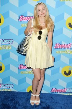 Dove Cameron, always pretty n wearing lovely dresses. Also has beautiful legs, I love them..Sal Peyton