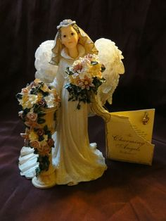 """Boyd's Collection CHARMING ANGELS  •Limited Edition January 1, 2003 - December 31, 2003 - Mine is numbered January 8210 •""""Marianna... Guardian of Brides Figurine...watches over and guides the blushing bride on her special day. She fills hearts with love and joy, blesses the day with sunshine and flowers, and fills the air with the delicate sounds of music. She is present from the very moment a bride slips on her engagement ring to the moment when she says, """"I Do."""""""