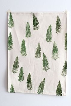I used real fern leaves for printing this tea towel. Just brush the fabric paint on the leaf and press it firmly against the fabric. When you're finished and the paint has dried completely, iron the fabric to make the prints waterproof.  I've purchased the wooden brushes recently and like them so much more than all the plastic ones.