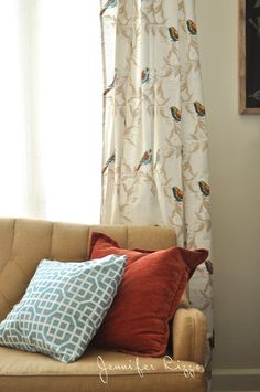 Target tablecloths made into living room curtains and napkins into pillows