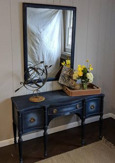 Painted 1960s or older bedroom vanity/ desk. Painted with Annie Sloan chalk paint, Napoleonic Blue and Old White. This piece was coated with Annie Sloan black wax. Drawers are lined with decorative paper. Mirror is of same vintage but not original with the piece and is also painted with the