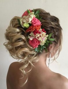 Breathtaking curly updo wedding hairstyle with statement flower hairpiece; Featured Hairstyle: ElStyle