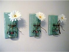 """Mason Jar Wall Sconce  *Painted robins egg blue with a white undercoat, then distressed for that shabby chic look  *Comes in a variety of colors  *A pint size mason jar is held on with a hose clamp  *Can be used for organizing office or craft room supplies, in the kitchen to organize spatulas and wooden spoons, in the bathroom to hold tooth paste and tooth brushes or in the mud room to hold your small gardening tools  *Measures 11"""" x 5 1/4"""" x 1""""  *Sold as a set of ..."""