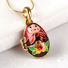 Nesting Doll Faberge Egg Locket <3 http://www.therussianstore.com/Faberge-Egg-Pendants.html