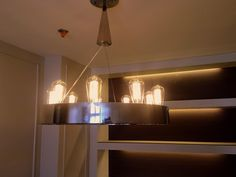 Modern or Vintage?A mixed design of polished stainless steel with Edison Filament bulb.