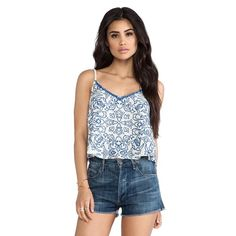 Dolce Vita Embroidered Crop Tank Dolce Vita Embroidered Cropped Tank Top. Sold out everywhere. Brand new without tag. No flaws. Originally $165. Can be dressed up or down. Beautiful soft blue embroidery details. Size XS. Perfect for festival season! Aritzia Tops Tank Tops