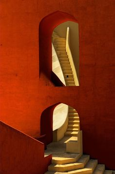 This is just a photo, no link, but too gorgeous not to pin this stairs framed in red from Morocco.