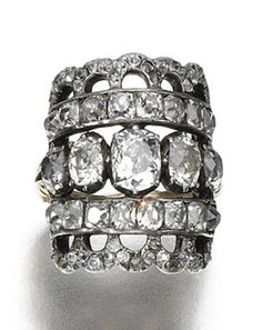 DIAMOND RING, CIRCA 1820 The open work plaque ring set with cushion-shaped, old mine and rose-cut diamonds, size N, French assay and import marks, later shank.