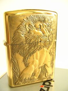 Lion Zippo [in memory of my beloved Mom who celebrated her birthdate under the powerful sign of Leo]♥