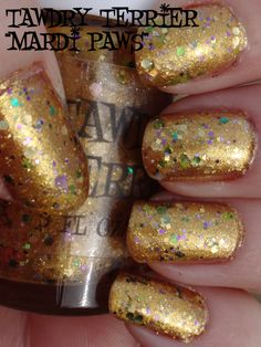 "Happy #MardiGras!  This is 1 coat of @TawdryTerrier ""Mardi Paws"" layered over 2 coats of @OPI Products ""Goldeneye"" - get your bottle of Mardi Paws at https://www.etsy.com/shop/TawdryTerrier. #nailpolish #indienailpolish #tawdryterrier"