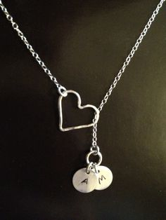 Our original necklace features the symbolic sterling silver heart charm and 2 hand stamped initial charms, each with your choice of initial. The perfect gift to symbolize your Infinite Love for family and friends. A very meaningful gift for someone special to you.    Sterling silver necklace, 17 *Heart sterling silver charm  *2 Sterling silver circle charms    Additional charms are available as a separate listing https://www.etsy.com/listing/127174040/hand-stamped-initial-sterling-silver…