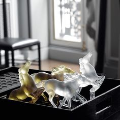 Kazak Horse: Captured in soft gold luster crystal and clear crystal, the movement of their manes flying in the wind evokes a spirit of freedom and independence.