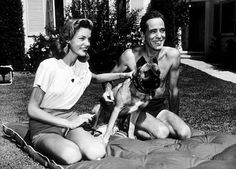 Humphrey Bogart and Lauren Bacall with their pet boxer at their Benedict Canyon home, CA, 1947.